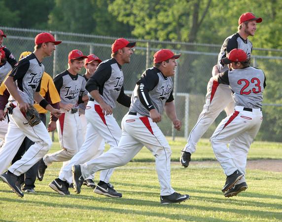 6-2-15<br /> Taylor vs Alexandria baseball<br /> The Taylor baseball team celebrates after beating Alexandria 2-1 for the sectional title.<br /> Kelly Lafferty Gerber | Kokomo Tribune