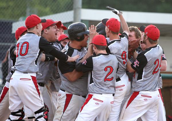 6-2-15<br /> Taylor vs Alexandria baseball<br /> The Taylor baseball team congratulates Tristan Kivett at home plate after Kivett scores a home run.<br /> Kelly Lafferty Gerber | Kokomo Tribune