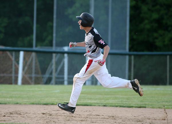 6-2-15<br /> Taylor vs Alexandria baseball<br /> Taylor's Tristan Kivett cheers as he runs the bases after scoring a home run.<br /> Kelly Lafferty Gerber   Kokomo Tribune
