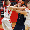Aaron Kirchoff/Rushville Republican<br /> Rushville's Bryce Dye and Oldenburg Academy's Ted Geis get tangled up following a scramble for a loose ball in the Lions' victory over the Twisters.