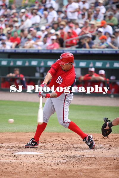Jose Lobaton of the Washington Nationals about to hit the ball