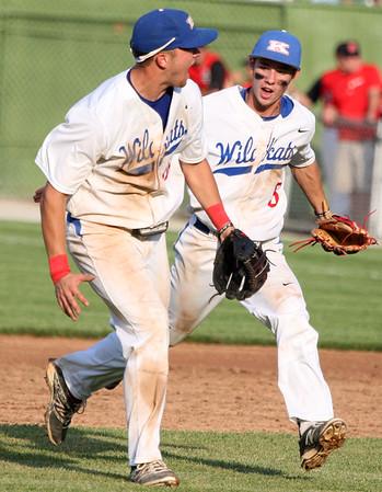 5-29-15<br /> Kokomo vs Western baseball<br /> Kokomo's Kyle Wade and Jared Dill celebrate after beating Western.<br /> Kelly Lafferty Gerber | Kokomo Tribune