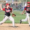 5-5-15<br /> Eastern vs Taylor baseball<br /> Taylor's Noah Poe throws to first.<br /> Kelly Lafferty Gerber   Kokomo Tribune