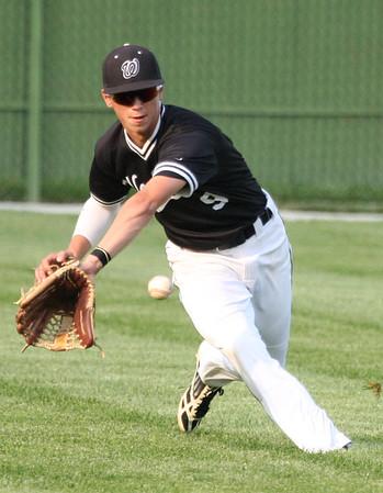 5-29-15<br /> Kokomo vs Western baseball<br /> Western's Lucas Florek scoops up the ball after it bounces in the outfield.<br /> Kelly Lafferty Gerber | Kokomo Tribune