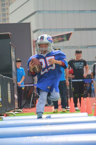 Wuhan University of Technology, Wuhan - A young fan tries his hand at being running back in the Running Back Challenge during the NFL Super Bowl Truck stop in Wuhan.