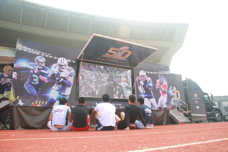 Wuhan University of Technology, Wuhan - NFL FLAG players watch game highlights during the NFL Super Bowl Truck Tour stop at their university.