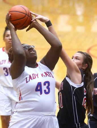 11-11-15<br /> Kokomo vs Taylor girls basketball<br /> Kokomo's Olivia Wilson shoots as Taylor's  Shaelah Eliason tries to block.<br /> Kelly Lafferty Gerber | Kokomo Tribune