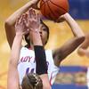 11-11-15<br /> Kokomo vs Taylor girls basketball<br /> Kokomo's Quaynika Merriweather shoots as Taylor's Brie Boehler tries to block.<br /> Kelly Lafferty Gerber | Kokomo Tribune