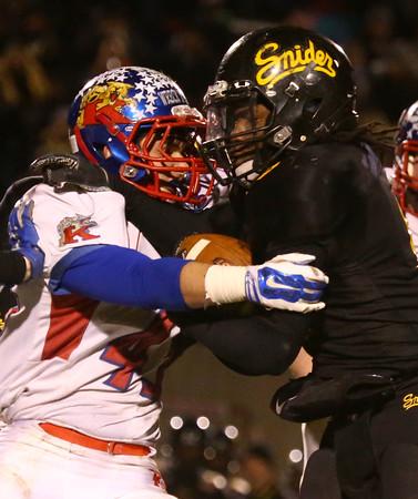 11-20-15<br /> Kokomo football semistate<br /> Noah Hurlock tackles a Snider ball carrier.<br /> Kelly Lafferty Gerber | Kokomo Tribune