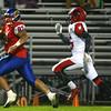 11-6-15<br /> Kokomo football sectional win<br /> Marcelle Kenner outruns Huntington North's Austin Sills for a touchdown<br /> Kelly Lafferty Gerber | Kokomo Tribune