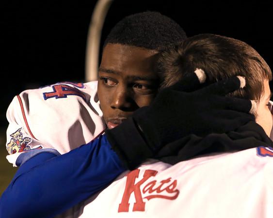 11-20-15<br /> Kokomo football semistate<br /> Titus Daniel hugs a teammate after the semistate loss.<br /> Kelly Lafferty Gerber | Kokomo Tribune