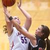 11-11-15<br /> Kokomo vs Taylor girls basketball<br /> Kokomo's Sieara Langley and Taylor's Lanee Butzin<br /> Kelly Lafferty Gerber | Kokomo Tribune