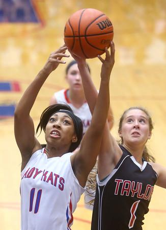 11-11-15<br /> Kokomo vs Taylor girls basketball<br /> Kokomo's Quaynika Merriweather and Taylor's Savannah Delgado go for the rebound.<br /> Kelly Lafferty Gerber | Kokomo Tribune