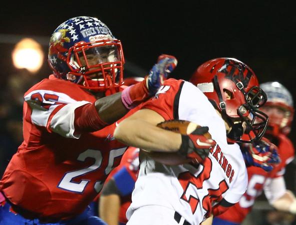 11-6-15<br /> Kokomo football sectional win<br /> DaShaun Barbary takes down Huntington North's Parker Thompson<br /> Kelly Lafferty Gerber   Kokomo Tribune