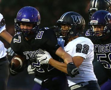 10-2-15 NWHS vs WHS football Northwestern's Evan Cardwell gets taken down Tanner Heady. Kelly Lafferty Gerber | Kokomo Tribune