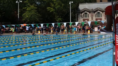 Mikaela (lane 5, closest to camera in gold cap), and Mirna (lane 2, second from top) swim the 50 Meter Freestyle at the NYC Parks Swim Championship at Pitt Street Pool, on Saturday August 15, 2015