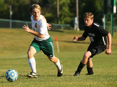 9-24-15 Eastern soccer Eastern's Ethan Campbell and Sheridan's Noah White. Kelly Lafferty Gerber | Kokomo Tribune