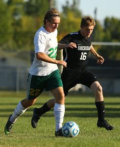 9-24-15 Eastern soccer Eastern's Dillon Ryan and Sheridan's Noah White. Kelly Lafferty Gerber | Kokomo Tribune