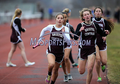 4/8/2015 Mike Orazzi | Staff Angela Barton gets the baton from Haley Knox during the girls 4x800 between Bristol Central and Plainville at BC Wednesday.