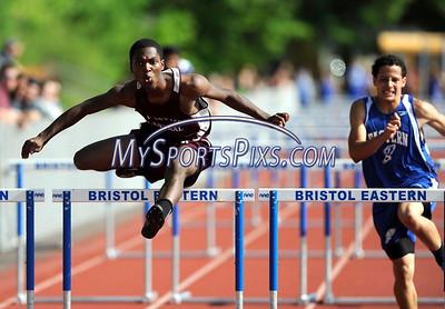 5/19/2015 Mike Orazzi | Staff Bristol Jevon Smith hurdles at Bristol Eastern on Tuesday.