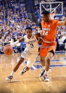 Kentucky's Tyler Ulis drives past Florida's Justin Leon on Saturday at Rupp Arena.  MARTY CONLEY/ FOR THE DAILY INDEPENDENT