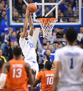 Kentucky's Marcus Lee leaps for a dunk against Florida on Saturday in Lexington.  MARTY CONLEY/ FOR THE DAILY INDEPENDENT