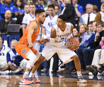 Florida's Chris Chiozza defends Kentucky's Tyler Ulis on Saturday in Lexington.  MARTY CONLEY/ FOR THE DAILY INDEPENDENT