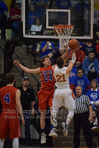 Hunter Sanford challenges a shot in the North Daviess game