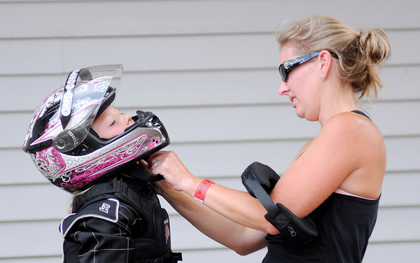 Don Knight | The Herald Bulletin<br /> Annie Eden helps her daughter Kendall, 9, with her helmet before she raced in the Alexandria Grand Prix on Saturday. Racing continues today with opening ceremonies at 1 p.m.