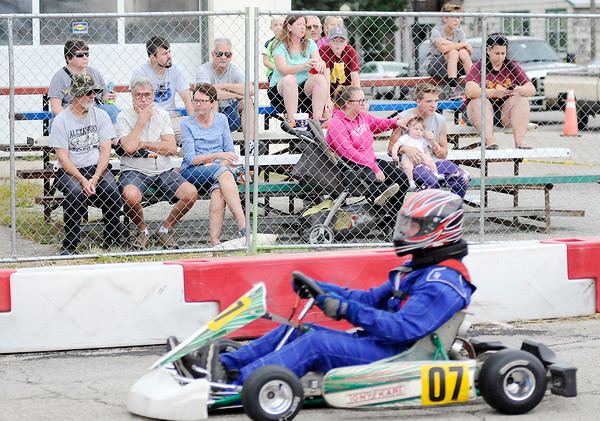 Don Knight   The Herald Bulletin<br /> Spectators watch drivers exit turn one from bleachers on West Broadway during the Alexandria Grand Prix on Saturday.