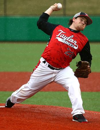 4-6-16<br /> Taylor vs Alexandria baseball<br /> Taylor's Noah Poe pitches.<br /> Kelly Lafferty Gerber | Kokomo Tribune
