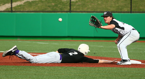 4-19-16<br /> Northwestern vs Western baseball<br /> Northwestern's Collin Hodson slides back to first safely as the pitcher throws to Western's Brayden DeWeese to try to pick him off.<br /> Kelly Lafferty Gerber   Kokomo Tribune