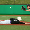 4-19-16<br /> Northwestern vs Western baseball<br /> Northwestern's Collin Hodson slides back to first safely as the pitcher throws to Western's Brayden DeWeese to try to pick him off.<br /> Kelly Lafferty Gerber | Kokomo Tribune