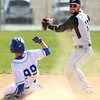 4-16-16<br /> Western vs Tipton baseball<br /> Western's Jacob Douglass looks to throw to first for an out after he gets Tipton's Harrison Finch out in a double out play.<br /> Kelly Lafferty Gerber | Kokomo Tribune