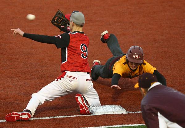 4-6-16<br /> Taylor vs Alexandria baseball<br /> Alexandria's Bryce Montgomery slides back to first just before Taylor'sJordan Maroney makes the catch.<br /> Kelly Lafferty Gerber   Kokomo Tribune