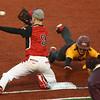 4-6-16<br /> Taylor vs Alexandria baseball<br /> Alexandria's Bryce Montgomery slides back to first just before Taylor'sJordan Maroney makes the catch.<br /> Kelly Lafferty Gerber | Kokomo Tribune
