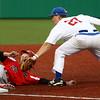 4-20-16<br /> Kokomo vs Logansport baseball<br /> Kokomo's Bayden Root tags Logansport's Max Weatherwax out at third.<br /> Kelly Lafferty Gerber | Kokomo Tribune