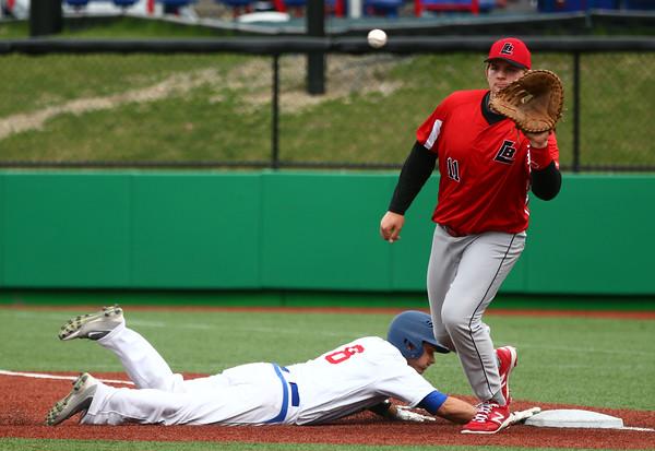4-20-16<br /> Kokomo vs Logansport baseball<br /> Kokomo's Noah Hurlock slides back to first safely as Logansport's pitcher and first baseman Jared Ehase tries to pick him off.<br /> Kelly Lafferty Gerber   Kokomo Tribune