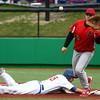 4-20-16<br /> Kokomo vs Logansport baseball<br /> Kokomo's Noah Hurlock slides back to first safely as Logansport's pitcher and first baseman Jared Ehase tries to pick him off.<br /> Kelly Lafferty Gerber | Kokomo Tribune