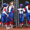 4-27-16<br /> Kokomo softball<br /> Sara Hughes and Courtland Cottle are congratulated by their teammates after scoring two runs.<br /> Kelly Lafferty Gerber | Kokomo Tribune