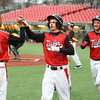 4-6-16<br /> Taylor vs Alexandria baseball<br /> Taylor's Evan Schroeder congratulates Treavor Harris and Cole Schroeder after they score the first two runs for Taylor.<br /> Kelly Lafferty Gerber | Kokomo Tribune