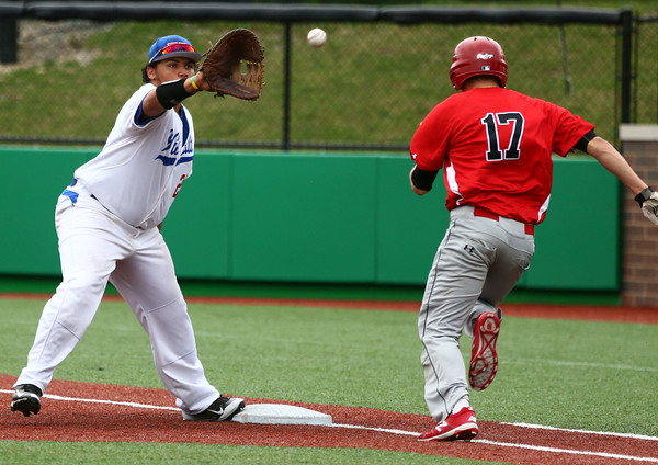 4-20-16<br /> Kokomo vs Logansport baseball<br /> Quamielle Belt catches the throw to first for an out for Logansport's Justin Schrock.<br /> Kelly Lafferty Gerber   Kokomo Tribune