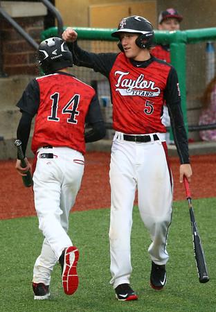 4-6-16<br /> Taylor vs Alexandria baseball<br /> Taylor's Stone Deckard congratulates his teammate Bailey Owens after Owens scores the eighth run of the game.<br /> Kelly Lafferty Gerber   Kokomo Tribune