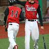 4-6-16<br /> Taylor vs Alexandria baseball<br /> Taylor's Stone Deckard congratulates his teammate Bailey Owens after Owens scores the eighth run of the game.<br /> Kelly Lafferty Gerber | Kokomo Tribune