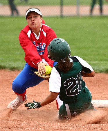 4-27-16<br /> Kokomo softball<br /> Pendleton Heights' Jayden Brown gets to second safely before Cathy Skaggs can tag her out.<br /> Kelly Lafferty Gerber   Kokomo Tribune