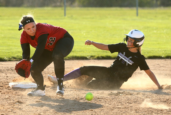 4-13-16<br /> Northwestern vs North Miami softball<br /> Northwestern's Bailey Thatcher slides to second safely before North Miami's Alicia Tooley can get her out.<br /> Kelly Lafferty Gerber | Kokomo Tribune