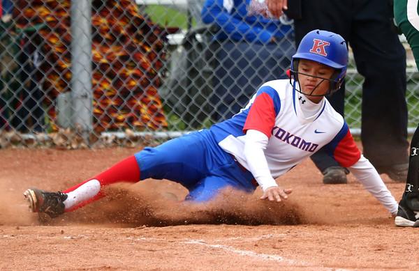 4-27-16<br /> Kokomo softball<br /> Lauryn Hicks slides safely home scoring the fourth run for the Kats.<br /> Kelly Lafferty Gerber   Kokomo Tribune