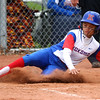4-27-16<br /> Kokomo softball<br /> Lauryn Hicks slides safely home scoring the fourth run for the Kats.<br /> Kelly Lafferty Gerber | Kokomo Tribune