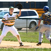 4-23-16<br /> Eastern vs Tri Central baseball<br /> Eastern's Manny Moreno catches the throw to first and gets Tri Central's Zander Beckom out.<br /> Kelly Lafferty Gerber | Kokomo Tribune