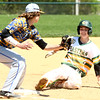 4-23-16<br /> Eastern vs Tri Central baseball<br /> Eastern's Zach Robinson slides safely to third before Tri Central's Noah Parish can get him out. Robinson went on to score the second run for the Comets.<br /> Kelly Lafferty Gerber | Kokomo Tribune